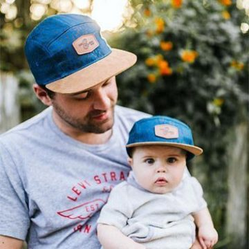 father and son wearing matching ball caps